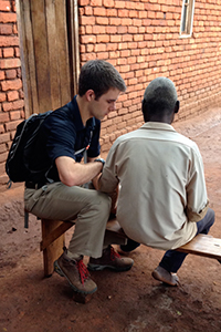 Dessel working with a patient during his trip to Malawi.