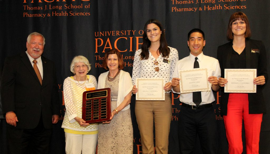 From left to right: Dean Oppenheimer, Lucille Gould, Karen Gould, Milana Vachuska, Johnny Hsia and Michaela Vachuska at the Pharmacy Scholarship Ceremony.