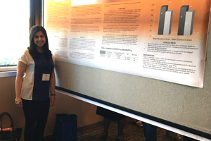 Ali with her poster at the conference.