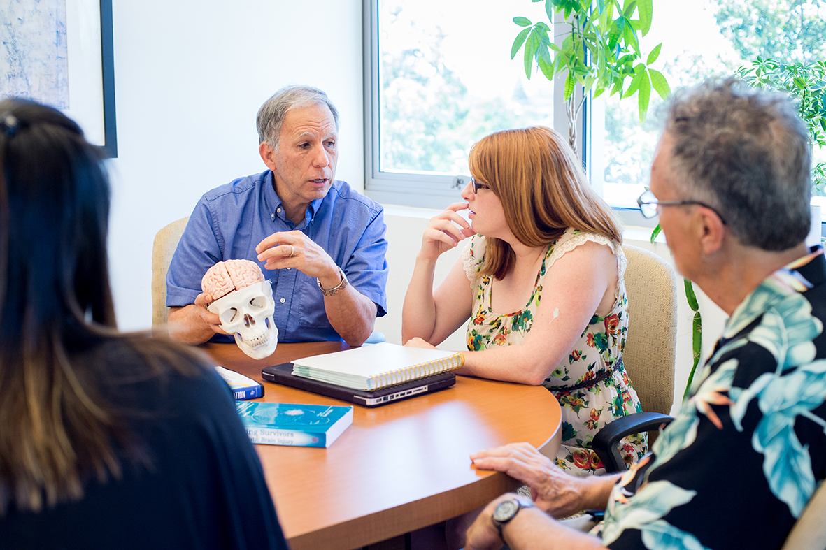 Speech language pathology faculty Michael Susca talks with students, June 20, 2017.